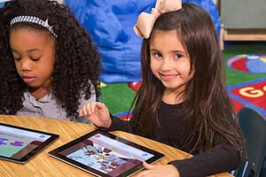 Photo of a girl using Istation on a tablet device.